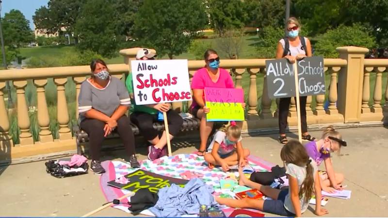 A group of Iowa mothers held a sit-in at the Iowa Capitol on Wednesday pushing Iowa Gov. Kim...