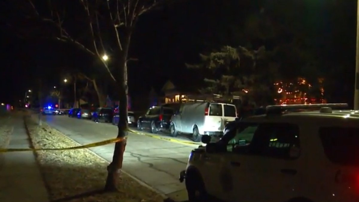 Investigators on the scene of a shooting in Des Moines during the early morning hours of...