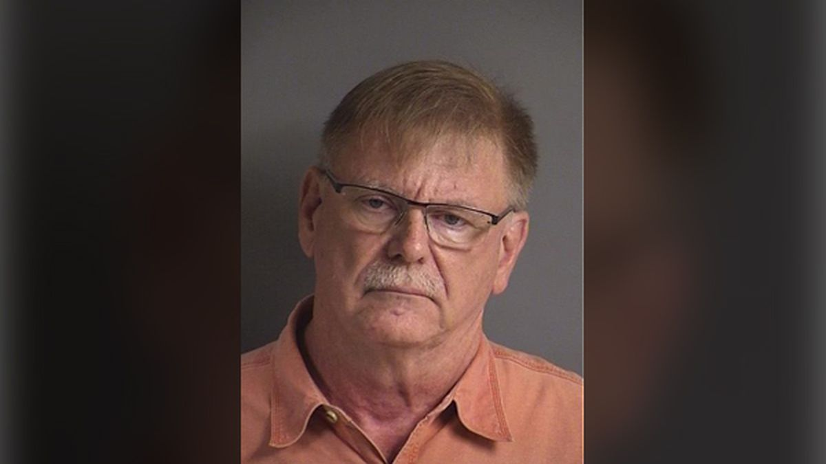 Robert Carlson, 67, charged with 22 counts of invasion of privacy after police say an employee...