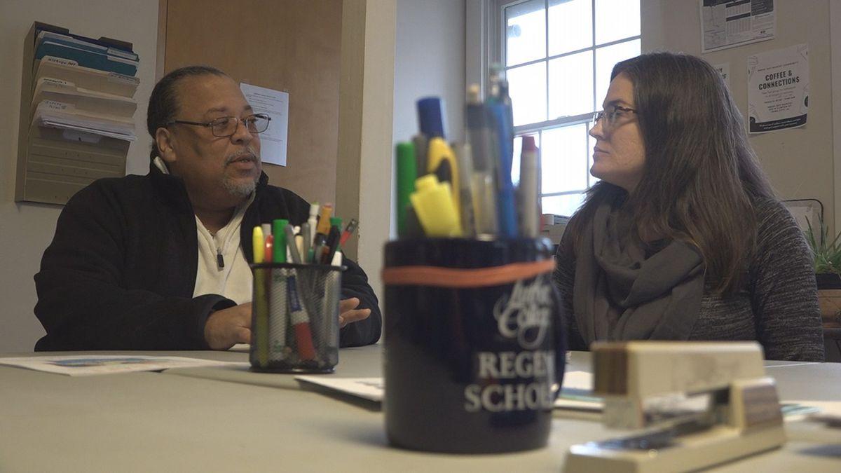 Eddie Walker (left) speaks with Michelle Heinz (right) at InsideOut Reentry Community in Iowa...