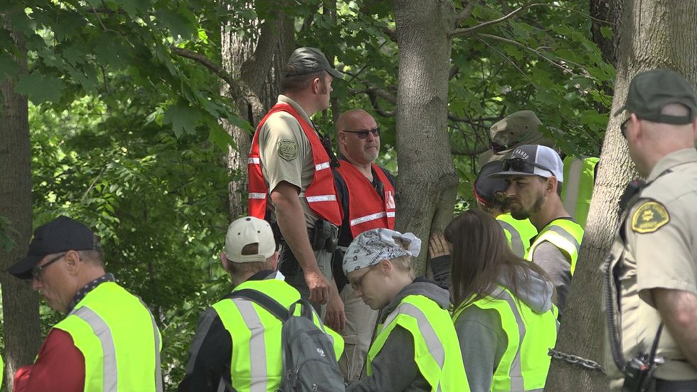 Volunteers gather to help with the search for 11-year-old Xavior Harrelson on Sunday, May 30,...
