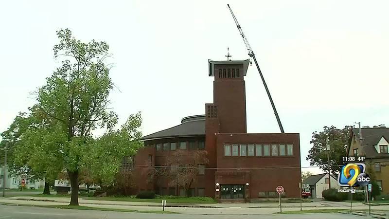 Crews returned a 12 foot high, illuminated cross back on top of Saint Paul's United Methodist...