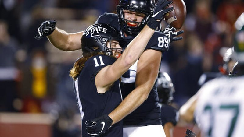 Iowa State tight end Chase Allen, left, celebrates his touchdown against Baylor with tight end...