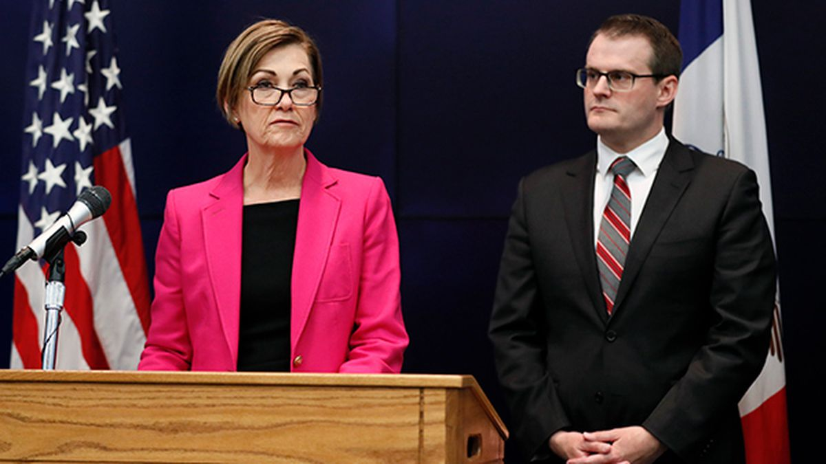 Iowa Gov. Kim Reynolds speaks during a news conference about an update on the state's response to the new coronavirus outbreak, Friday, March 13, 2020, in Johnston, Iowa. Iowa Lt. Gov. Adam Gregg, right, looks on. (AP Photo/Charlie Neibergall)