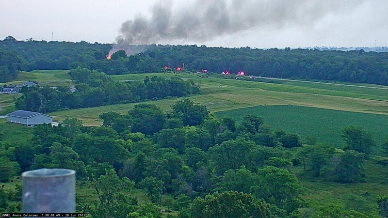 Multiple fire departments are responding to a fire near the Amana Colonies Golf Club.