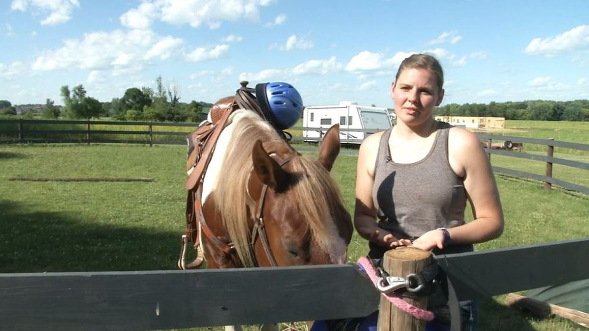 Morgan Reinboldt of Lisbon is helping train unbroken horses so they may be adopted. (Ethan...