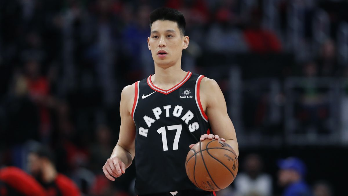 FILE - Toronto Raptors guard Jeremy Lin brings the ball up court during the first half of an...