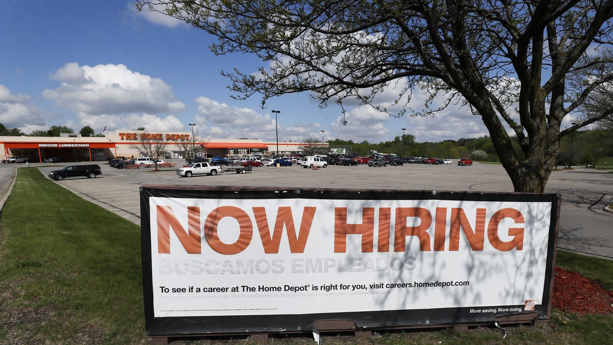 A now hiring sign is seen in front of a Home Depot store, Wednesday, May 6, 2020, in Des...