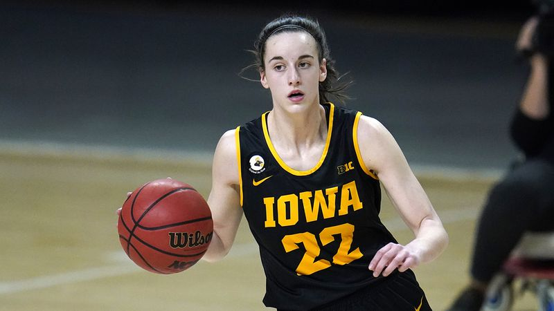 Iowa guard Caitlin Clark dribbles up court against Maryland during the first half of an NCAA...