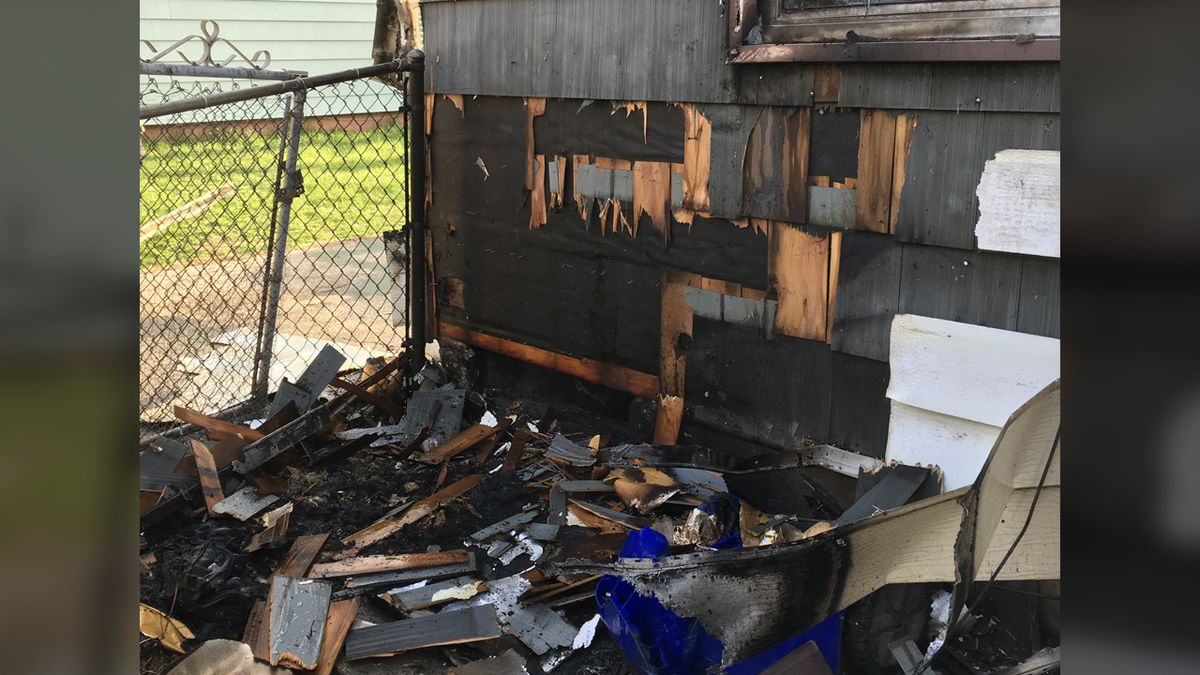 Damage from a fire outside of a home in the 4200 block of Benton Street NE on Sunday, April 18,...