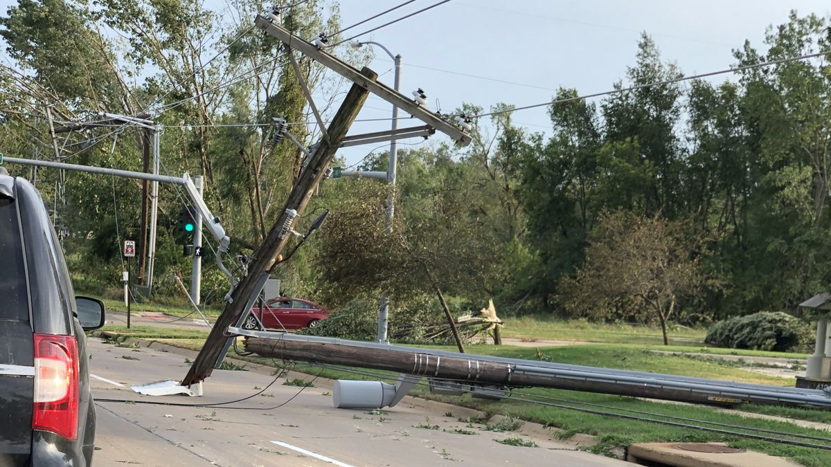 Utility poles lay damaged in Robins following intense thunderstorms on Monday, August 10, 2020.