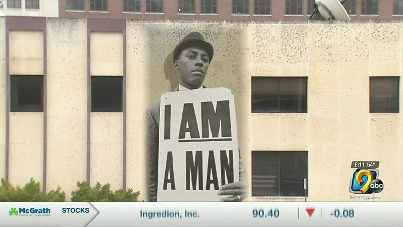 """The mural is inspired by the iconic """"I am a man"""" photo from the Civil Rights Movement."""