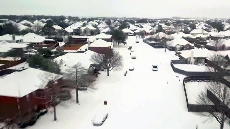 Snow blankets the ground in Texas during a record cold snap.