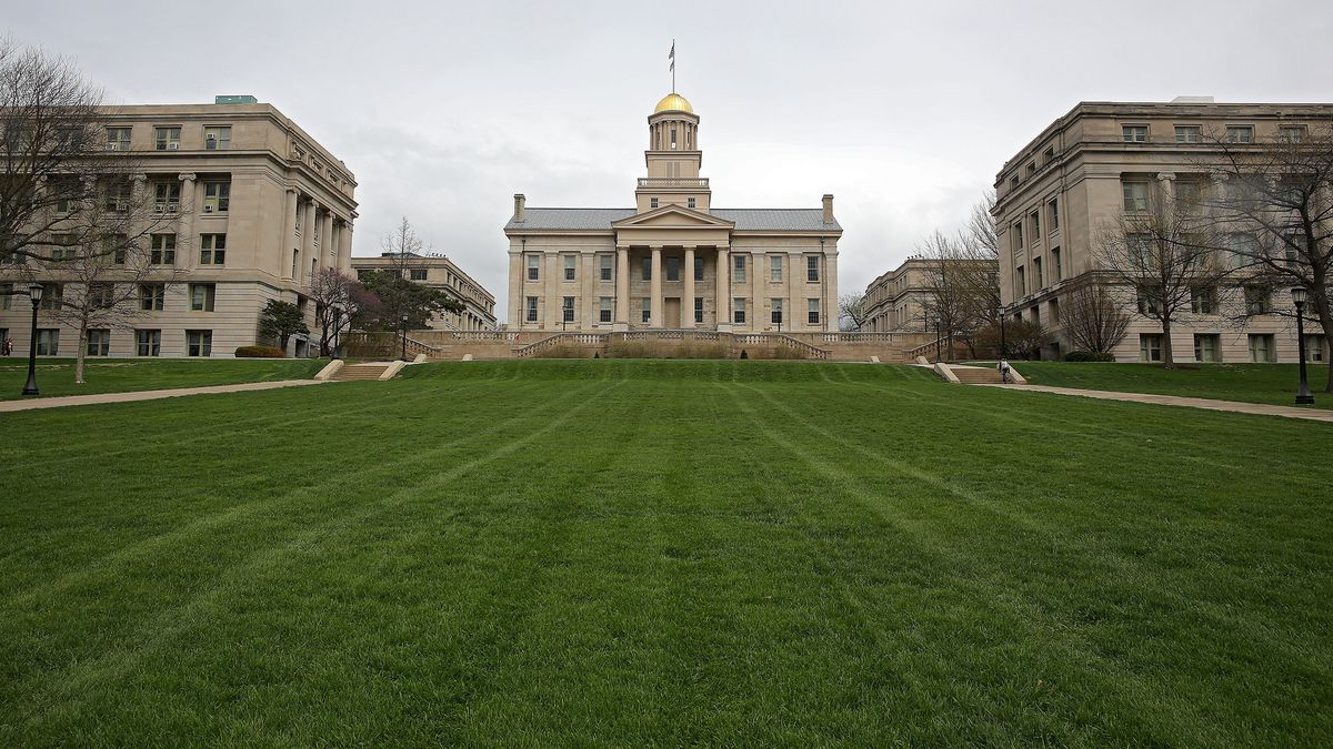 The Old Capitol Building between Jessup Hall (left) and MacLean Hall (right) on the Pentacrest on campus of the University of Iowa in Iowa City on Wednesday, April 30, 2014. (Stephen Mally/The Gazette-KCRG TV9)