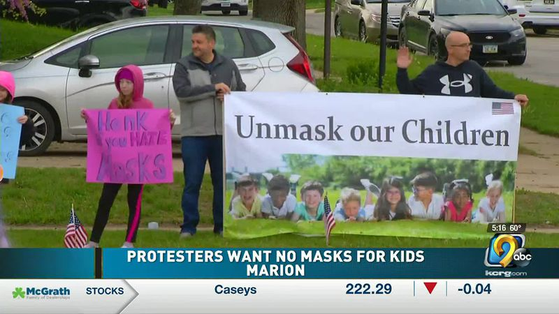 Protesters outside Novak Elementary School in Marion want masks to be optional