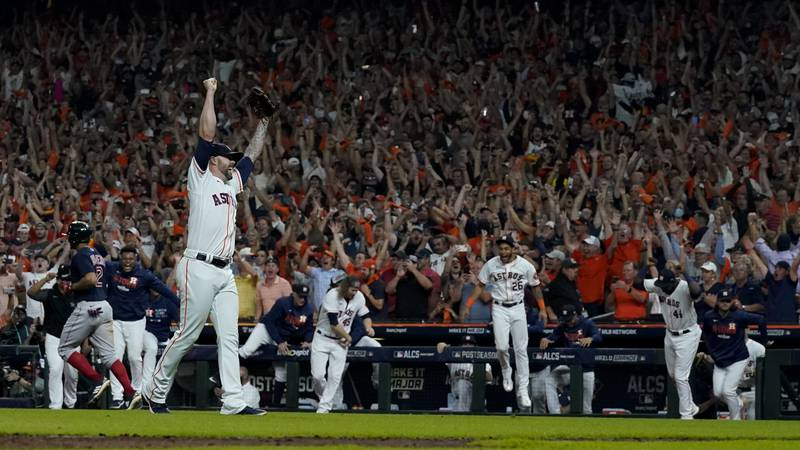 Houston Astros pitcher Ryan Pressly celebrates their win against the Boston Red Sox in Game 6...