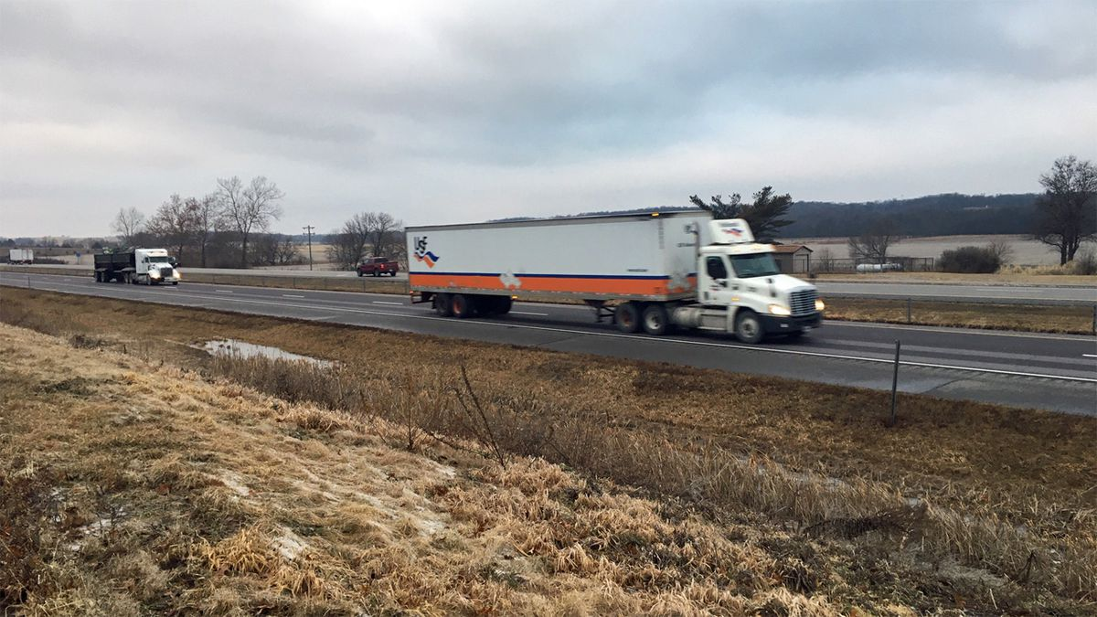 Trucks drive along Interstate 80 west of Iowa City on Wednesday, Jan. 15, 2020. The Iowa Department of Transportation warned drivers to steer clear of a 75-mile stretch of I-80 because of icy roads earlier in the morning. (Mary Green/KCRG)