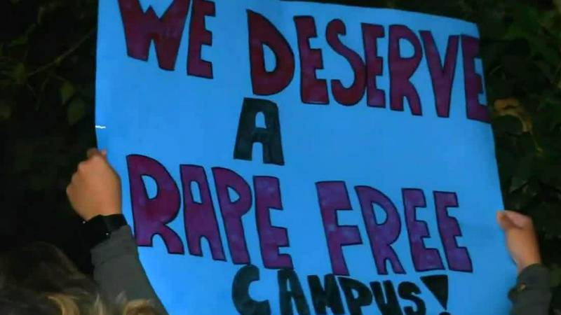 A sign held by a protester outside of the Phi Gamma Delta fraternity house in Iowa City on...