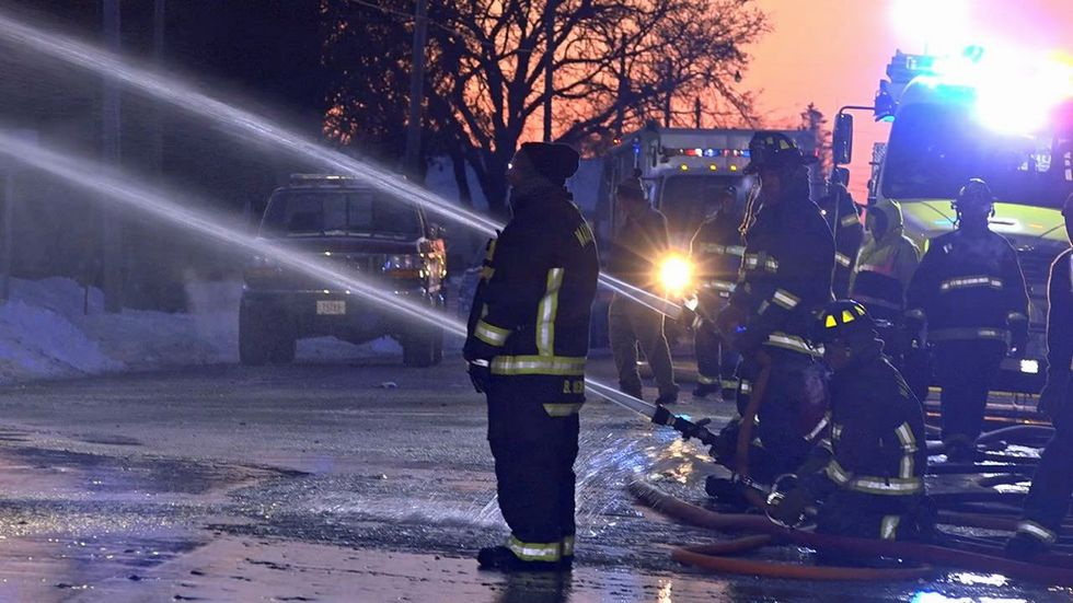 Fire crews work to put out the smoke at Gus and Tony's on Monday, Feb. 10, 2020 in Waukon...