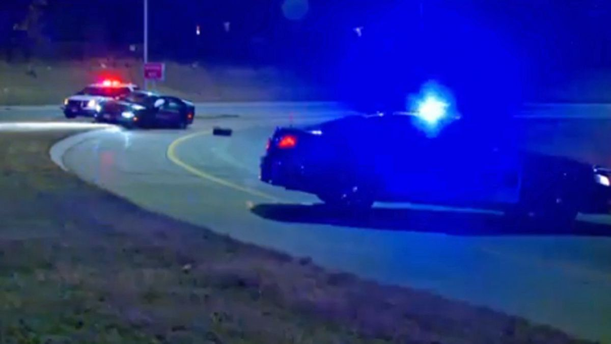 Police vehicles block an exit ramp in along Interstate 235 on Saturday, Dec. 7, 2019. Officials said the vehicle led officers on a high-speed chase before crashing, then the driver fled on foot (KCCI)