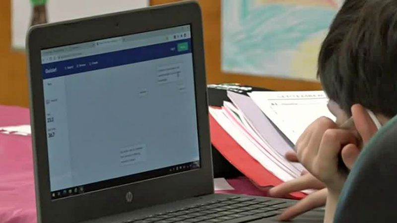 A student using a laptop computer.