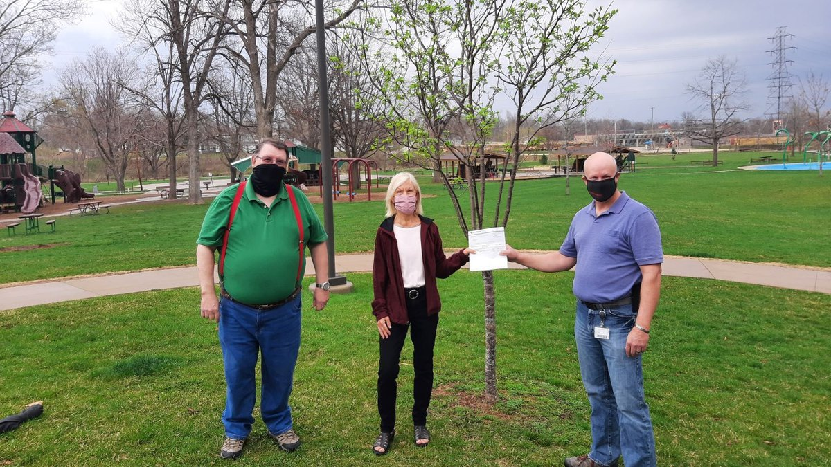 Greg Wildebour (right), with MidAmerican Energy, presents Marion Tree Board members Joe Spinks...