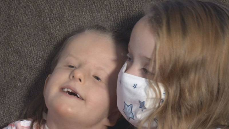Becca Salls, 5 (right), with her sister Cora, 7