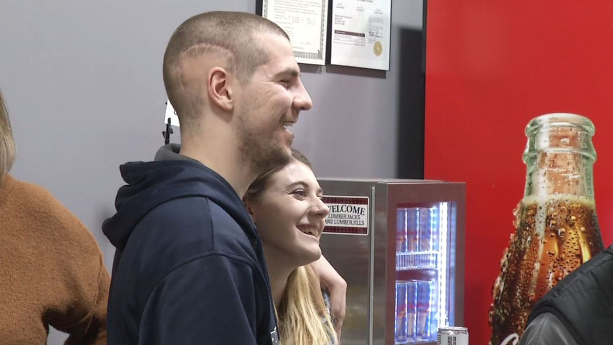 Bo Olson has fun with his friends and family during a fundraising event at Hatchet Jack's in...