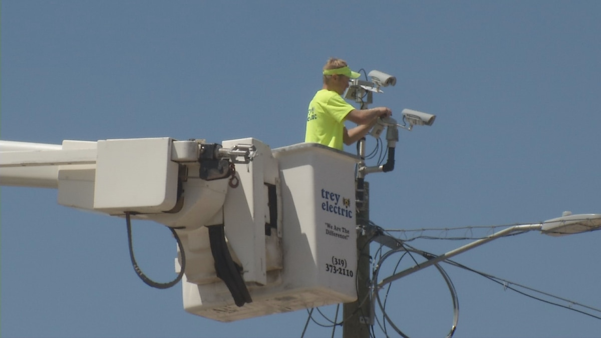 Crews in Cedar Rapids work to restore power following Monday's strong storm.