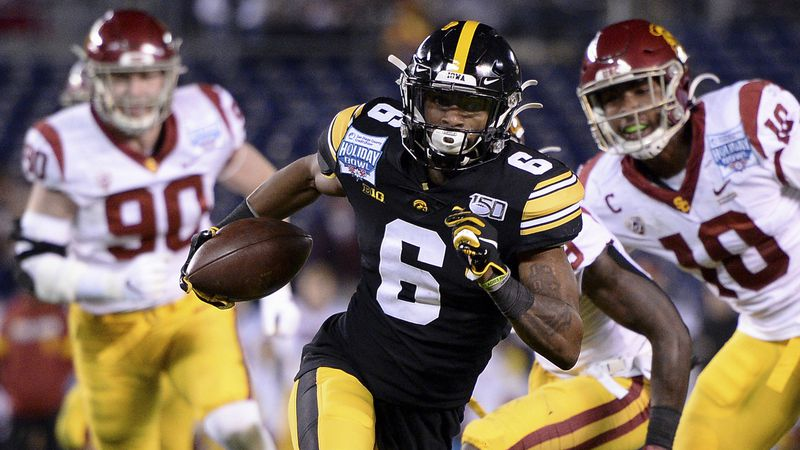 FILE - In this Dec. 27, 2019, file photo, Iowa wide receiver Ihmir Smith-Marsette (6) runs with...