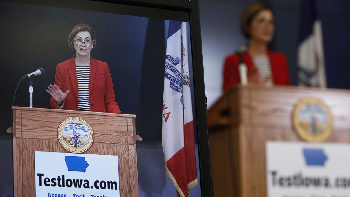 Iowa Gov. Kim Reynolds is seen on a monitor as she updates the state's response to the coronavirus outbreak during a news conference at the State Emergency Operations Center, Thursday, April 30, 2020, in Johnston, Iowa.  (AP Photo/Charlie Neibergall, Pool)