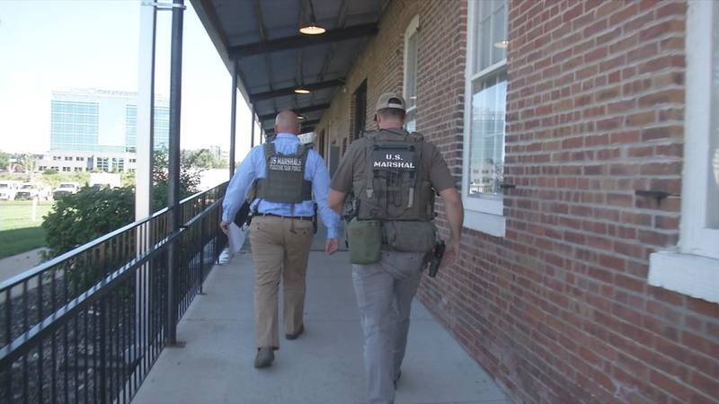 Members of US Marshal helping with sex offender compliance check in Linn County.