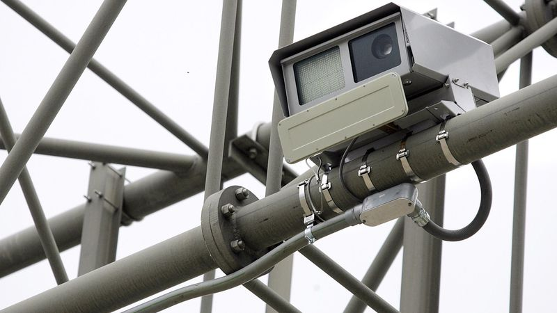 Radar-enabled speed cameras are attached to a sign post as traffic moves along northbound...