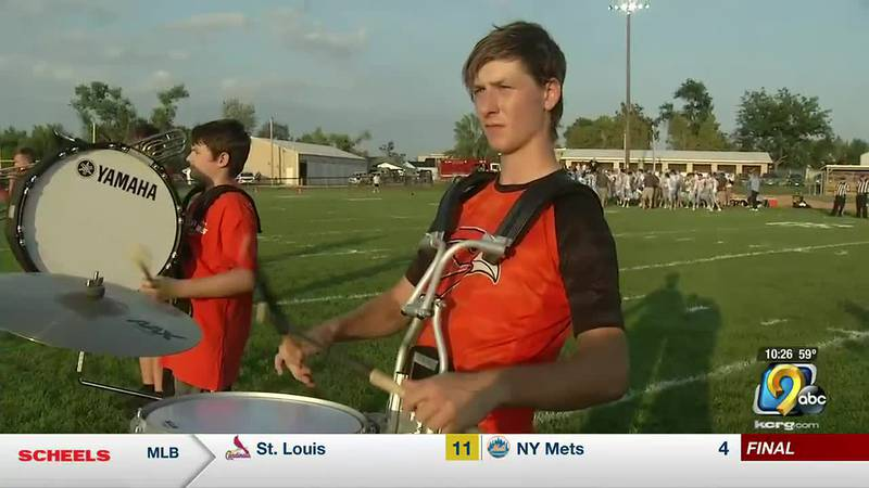 It's not easy to play in the band and the game, especially if you're the team's kicker.