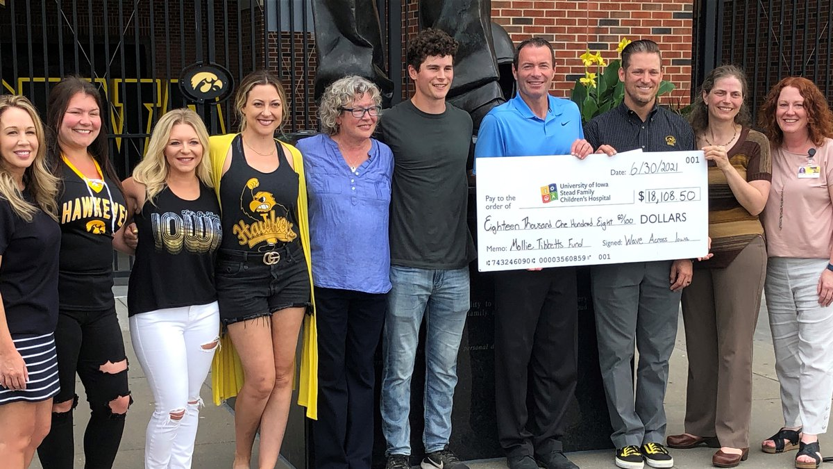 Group that ran from Iowa City to Davenport presenting the check to the University of Iowa, and...