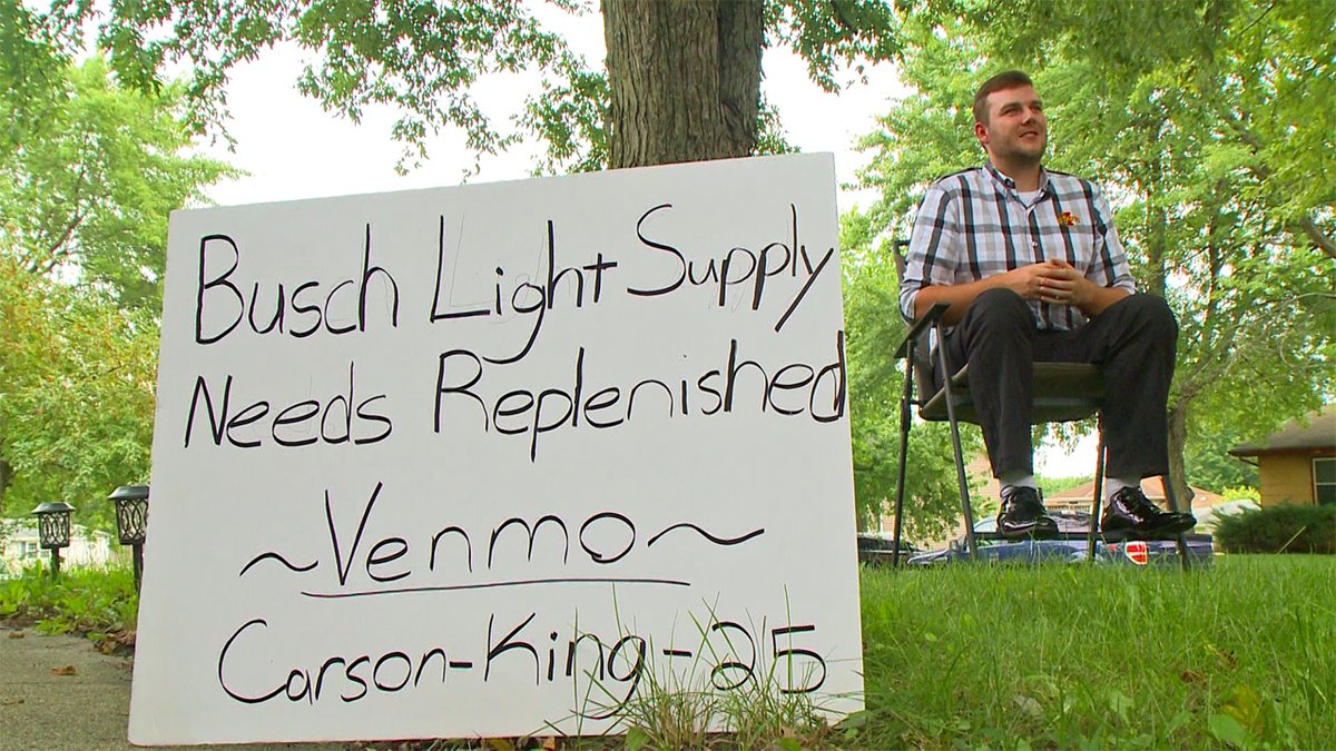 Carson King, 23, pictured with the sign he held up in the audience of ESPN's College GameDay in...