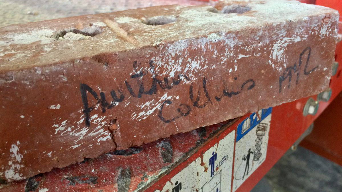 A brick with the signature of Collins Radio founder Arthur Collins discovered by construction...