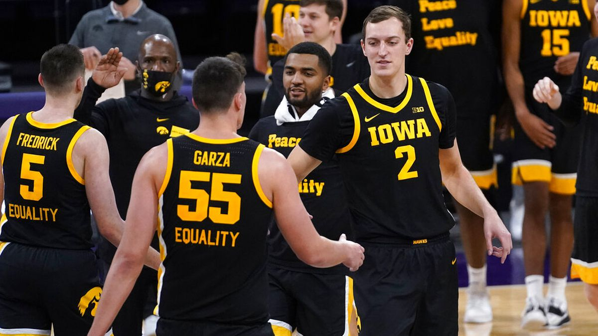 Iowa forward Jack Nunge (2) celebrates with center Luka Garza (55) during the second half of an...