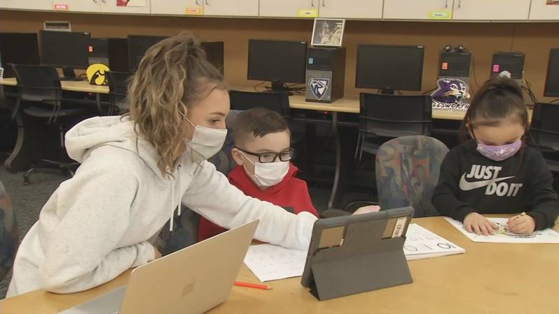 Student of the Month Shye Johnson helps her siblings with their learning