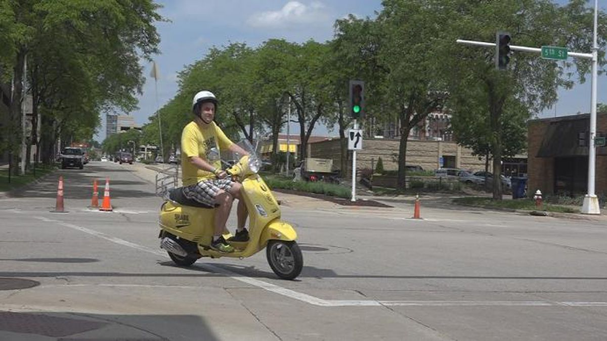 Jeff Lenhart rides his Vespa scooter in Dubuque. (Aaron Scheinblum, KCRG-TV9)