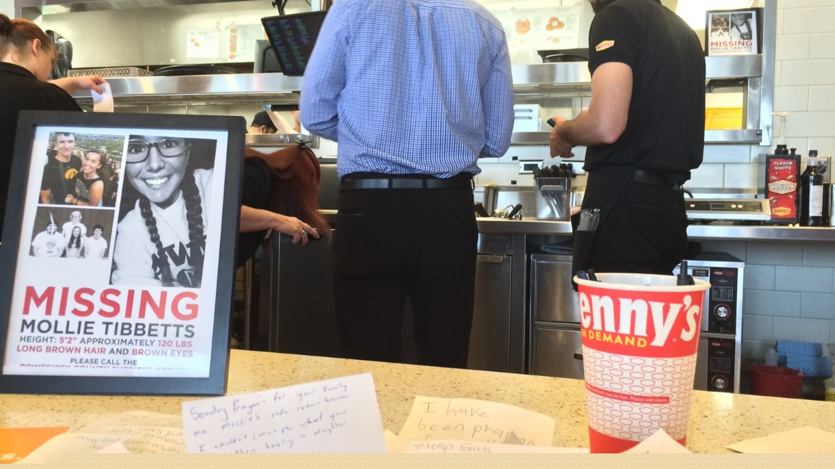 Information about Mollie Tibbetts sits on a counter at the Denny's Restaurant at I-80 and...
